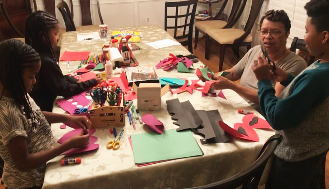 Grandmother doing arts and crafts with grandkids