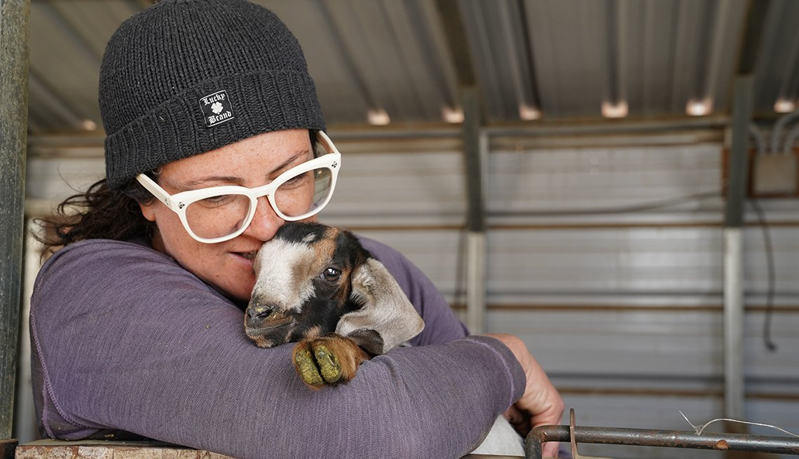 item 13 of Gallery image - Gloria Putnam with a goat.