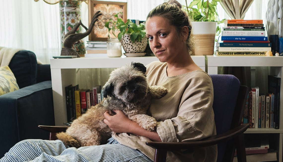 item 12 of Gallery image - jayme gershon holds her dog krizo on her lap