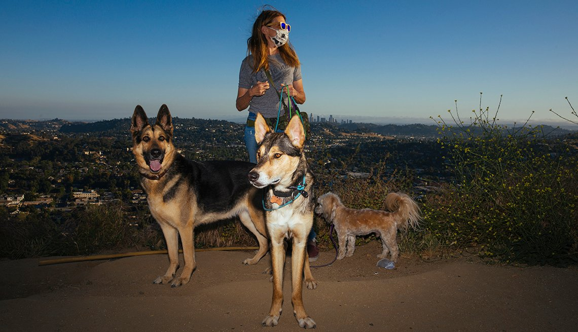 item 10 of Gallery image - Teresa Apollo with three dogs.
