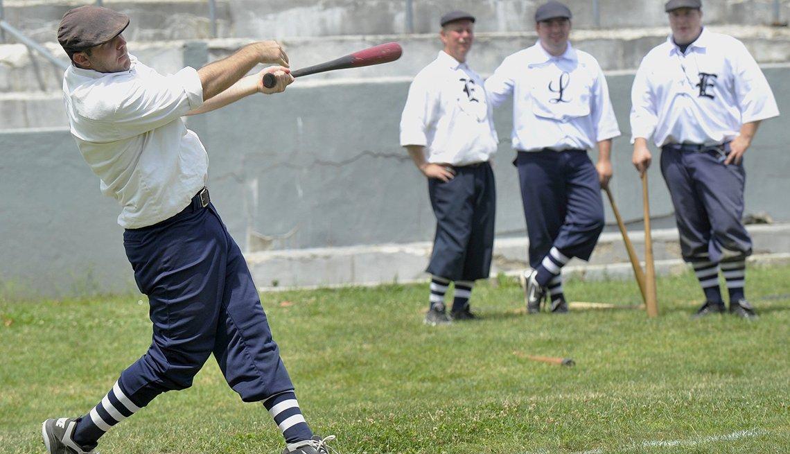 A man swings a bat at a baseball game