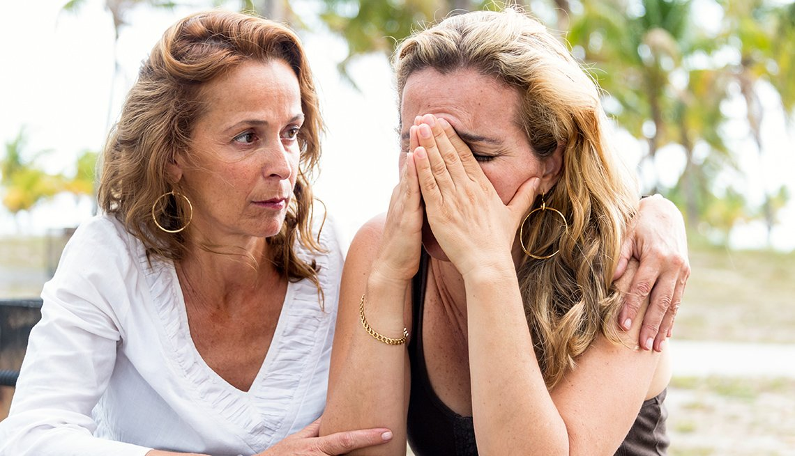 Woman being comforted by her friend