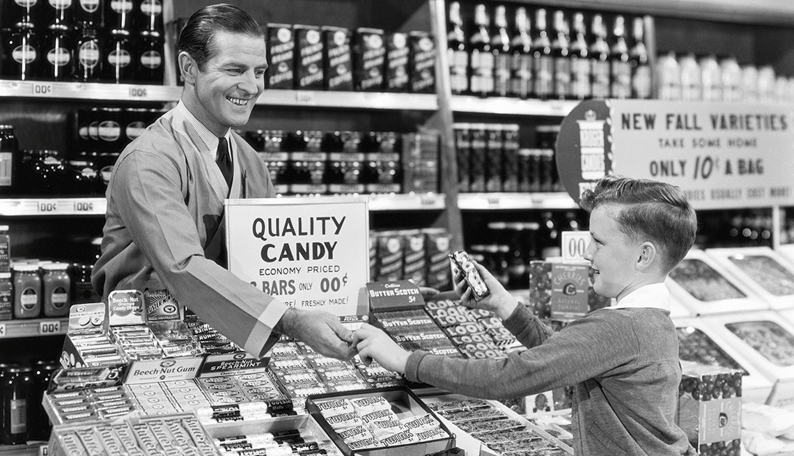 Vintage photo of a boy buying candy in a candy store