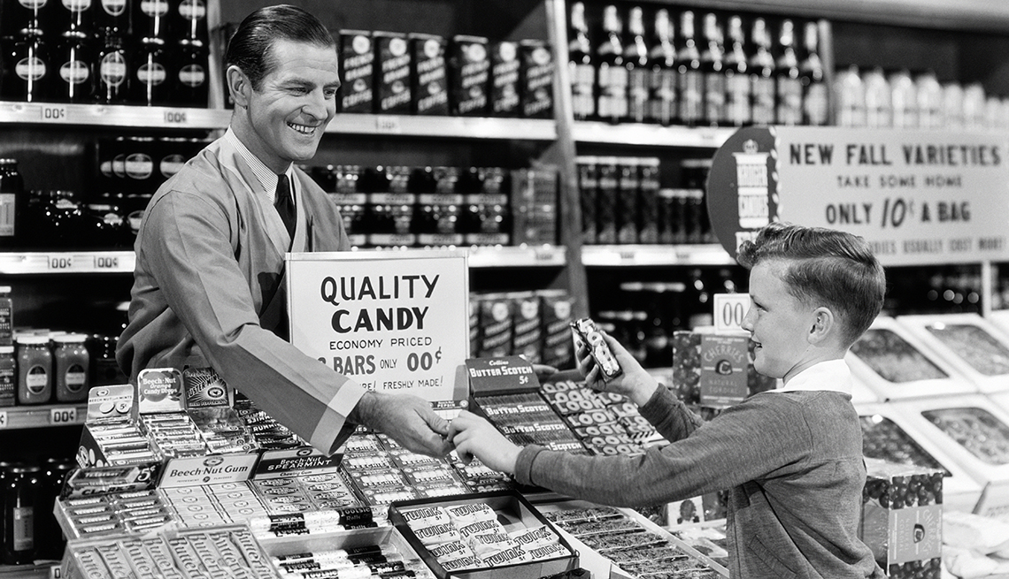 item 1 of Gallery image - Vintage photo of a boy buying candy in a candy store