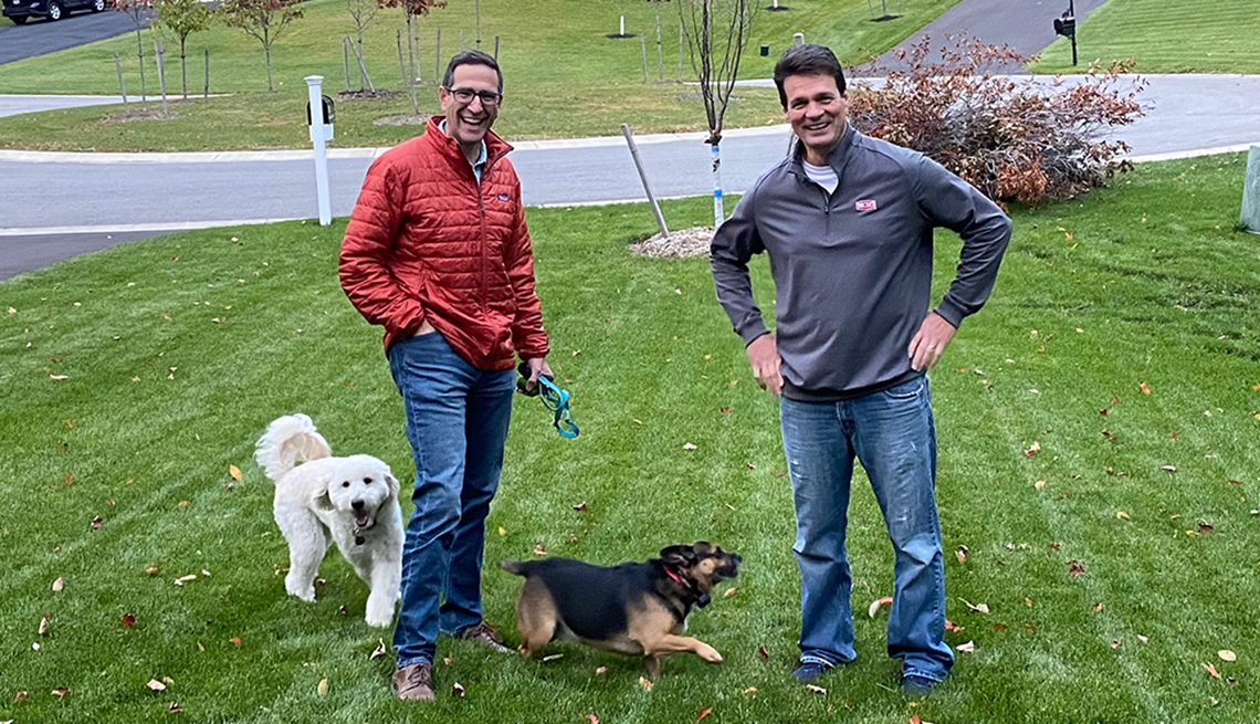 Harvey Beldner (left) and his golden doodle Seamus meeting a new neighbor Stephen King (right) and his pup Owen.