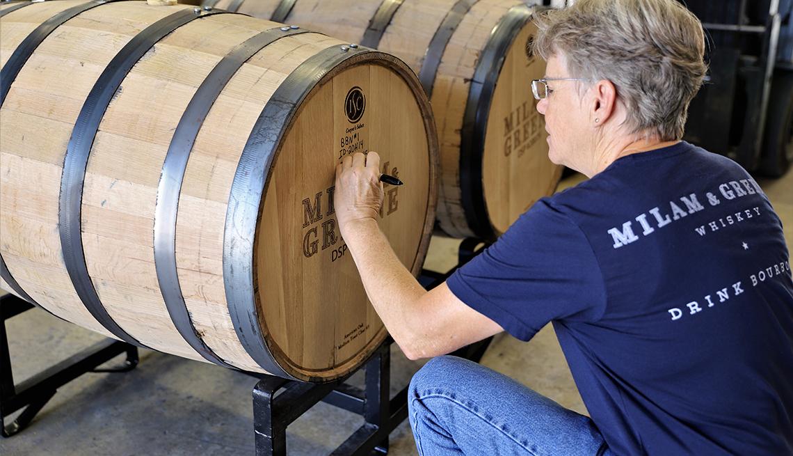 Marlene Holmes writing on a barrel