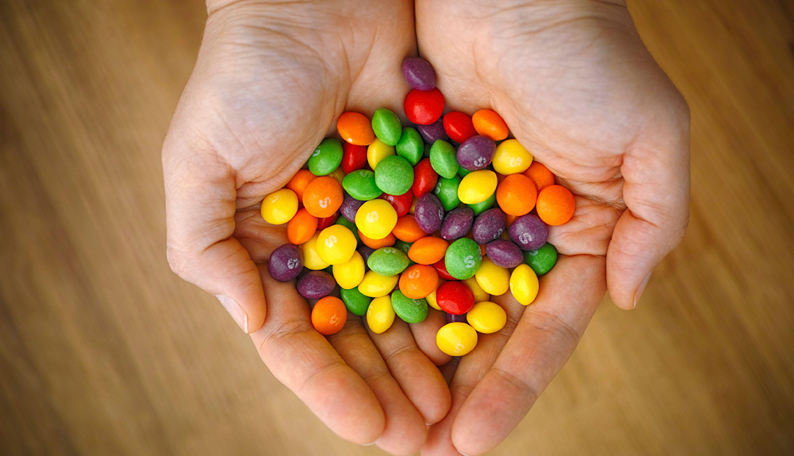 item 8 of Gallery image - Skittles in hand