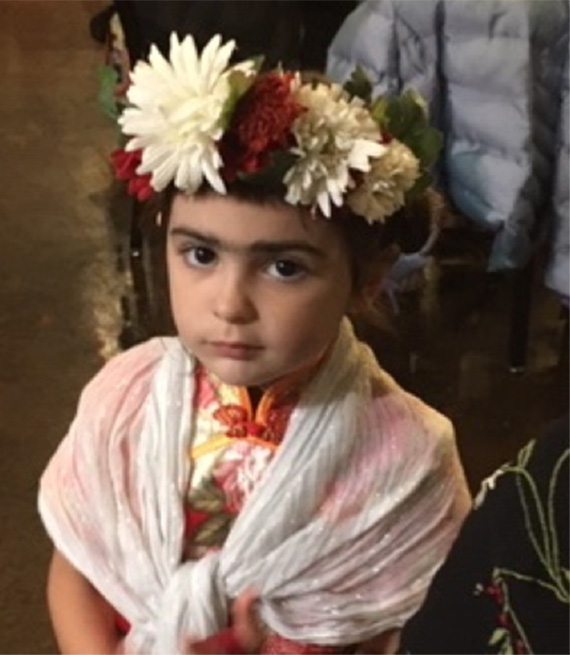 Child dressed as Frida Khalo