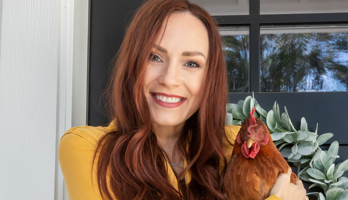 Chris Lesley and her chicken