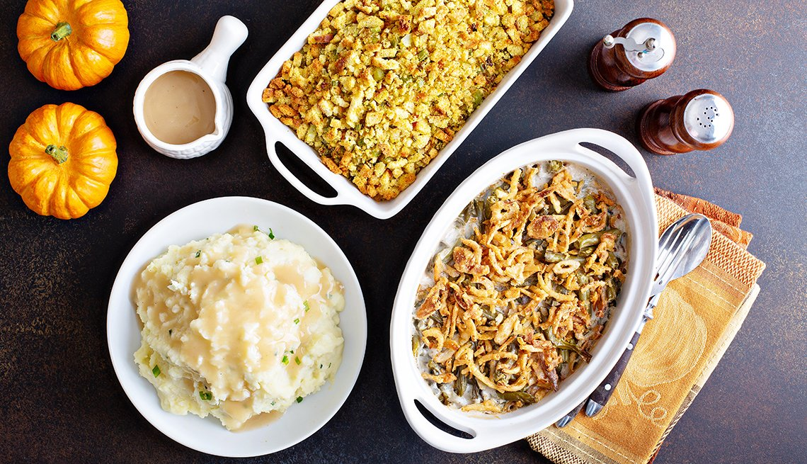 All traditional Thanksgiving side dishes, mashed potatoes, green beans and stuffing