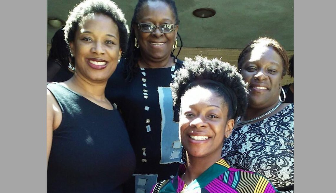 Jacqueline Burgess with her three daughters