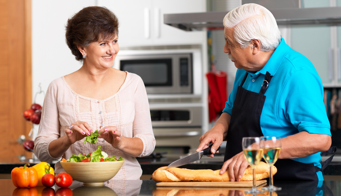Couple preparing a light dinner together with some wine