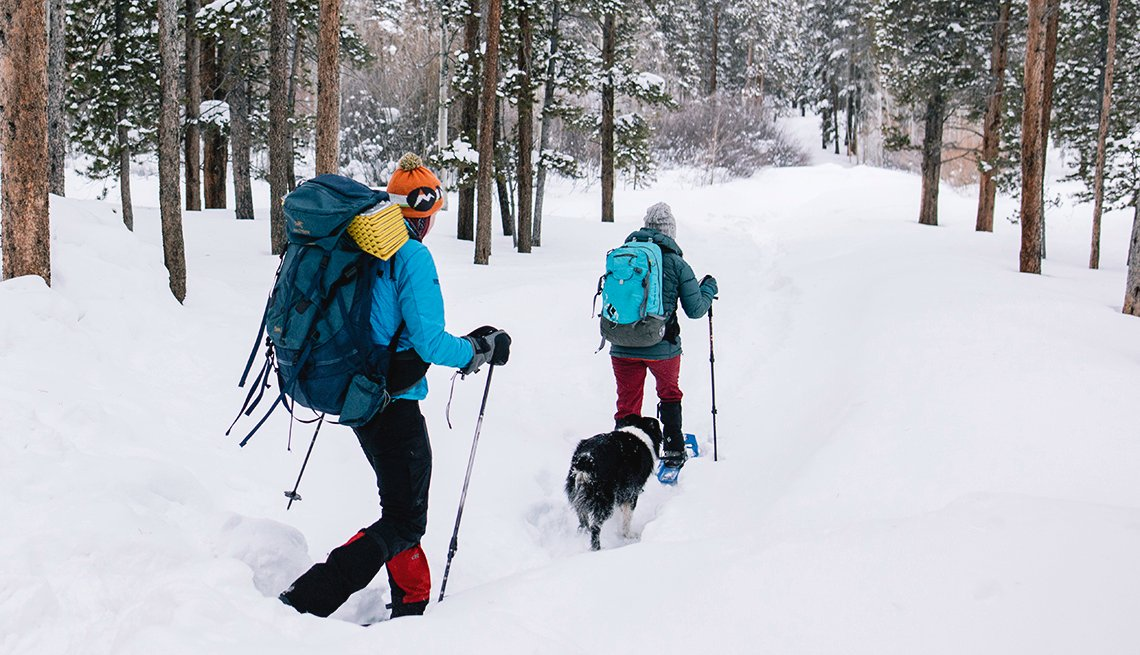 It's important to wear gear, such as leg gaiters, to stay warm and dry when snowshoeing in deep snow.