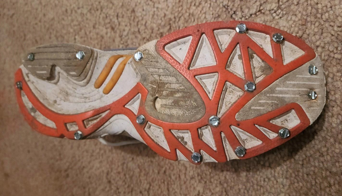 Jilly Whiting of Illinois puts sheet metal screws into the bottom of her running shoes for better traction in the winter