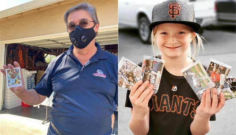 A man and a young girl hold up baseball cards
