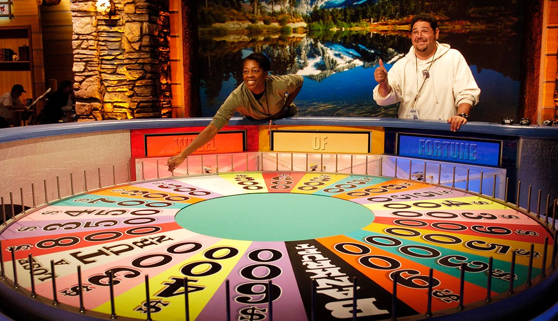 Two contestants on Wheel of Fortune
