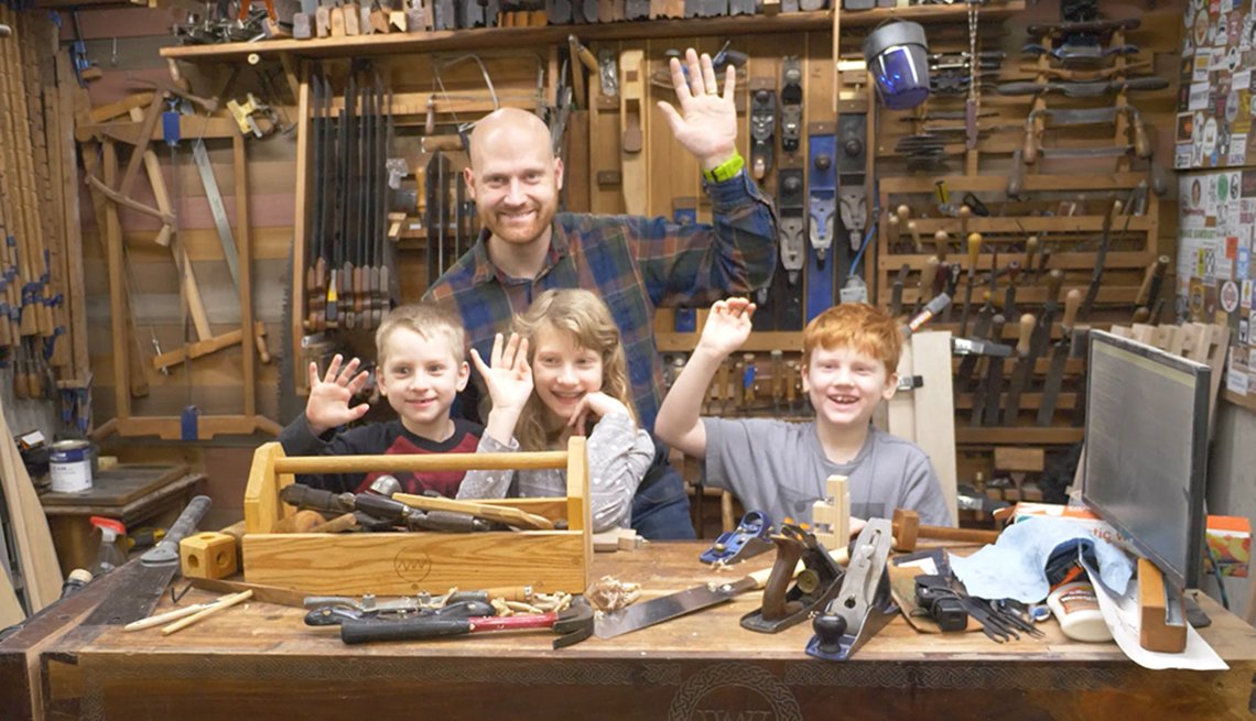 James Wright is passing on his woodworking skills to his children Arthur, Melody and JJ