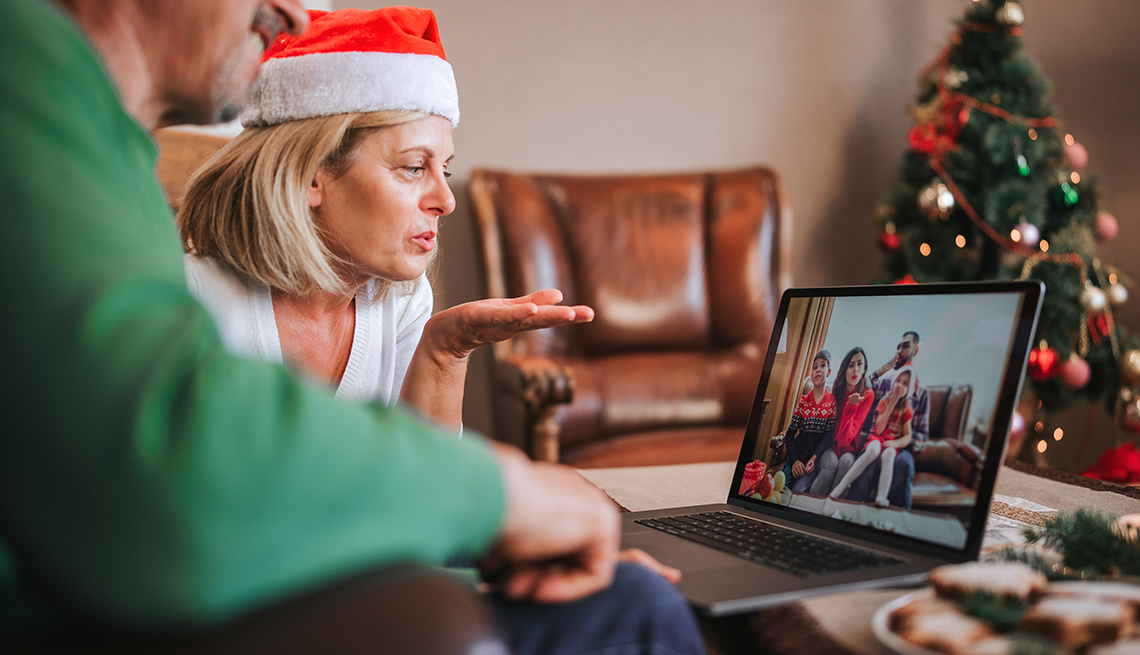 two people have a computer visit with family members during the holidays