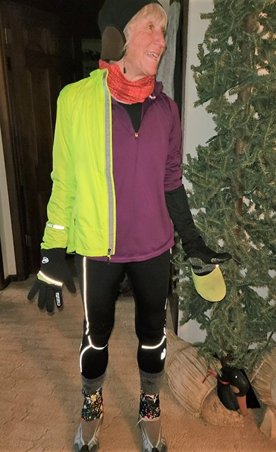Jilly Whiting of Illinois wears many layers, a hat, gloves and wool socks when running in the winter.