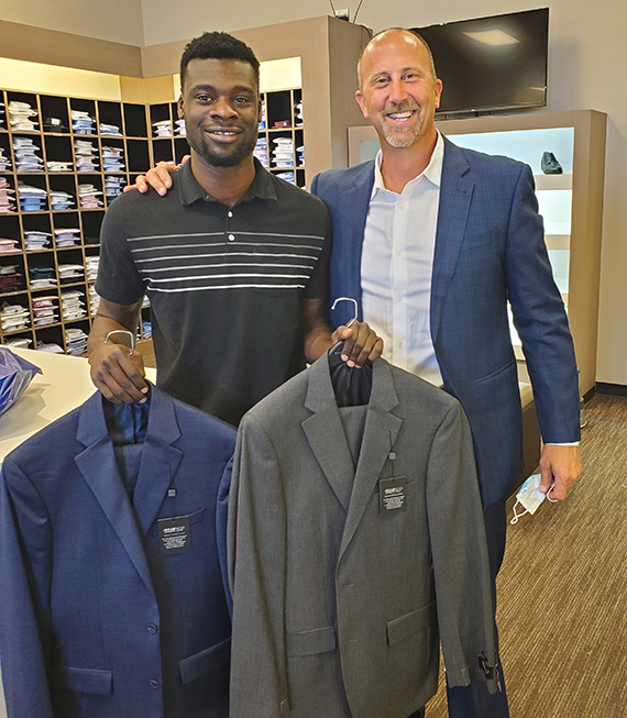 Impressed by Michael Phillips (left), who lived out of his car to save money and pay for his real estate license, Scot Johnston bought him a more professional wardrobe.