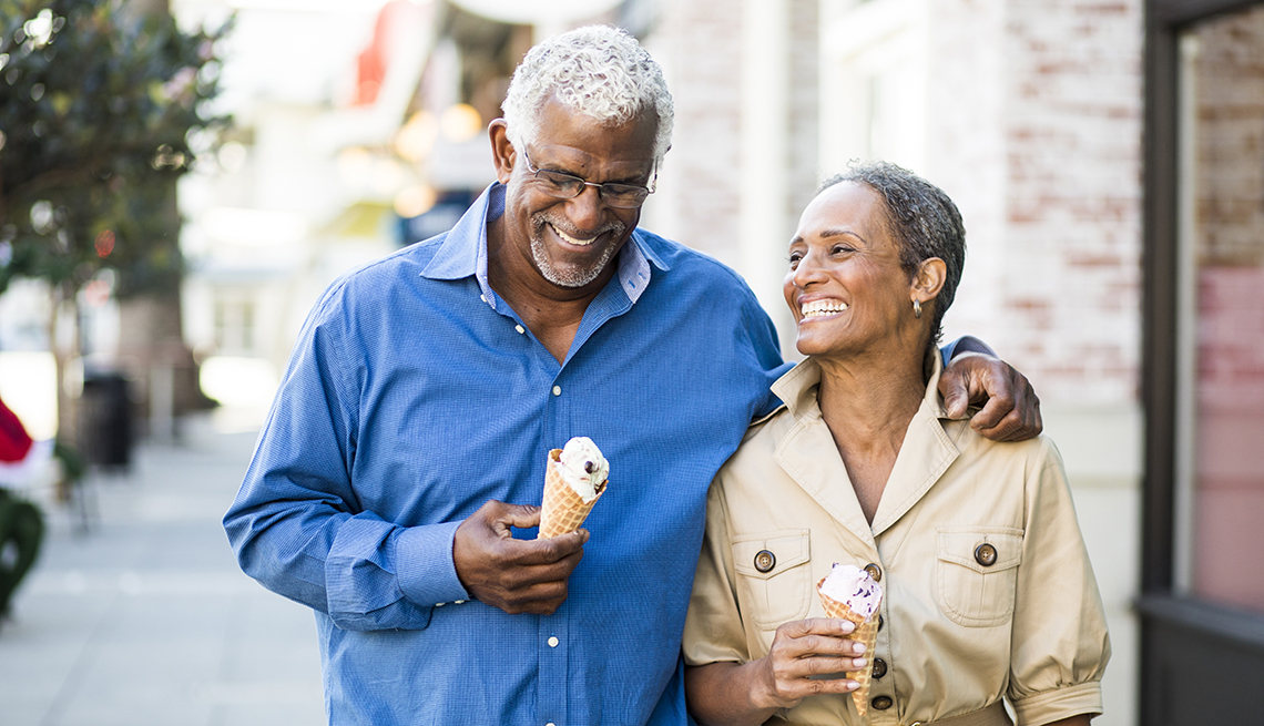 A mature couple enjoy an evening on the town with ice cream