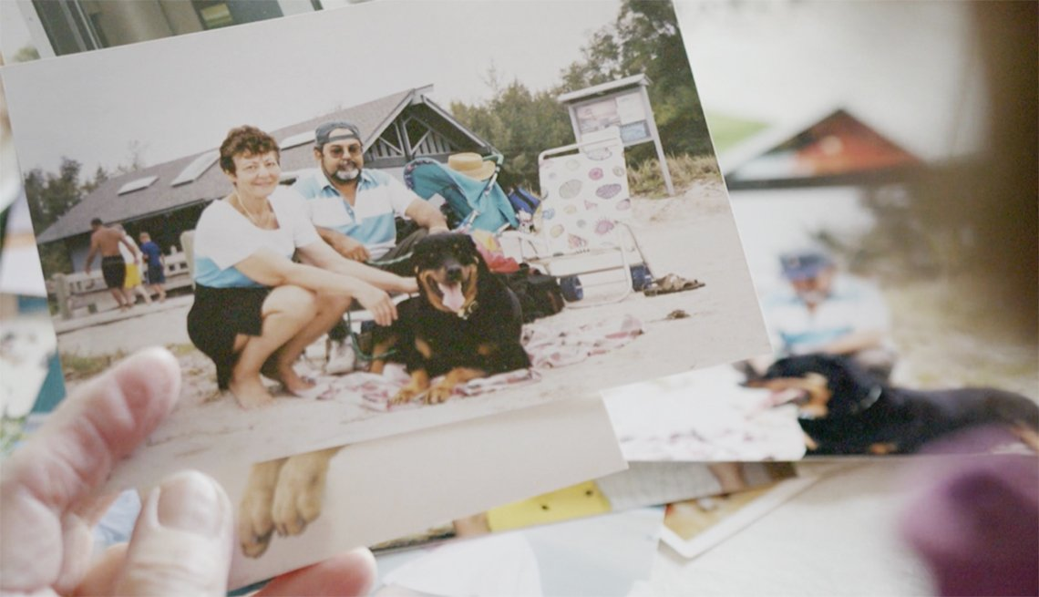 Pet rottweiler and family at the beach
