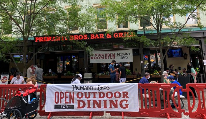 Patrons sit at a restaurant in downtown Pittsburgh, Pennsylvania, on July 25, 2020, amid the Coronavirus outbreak.