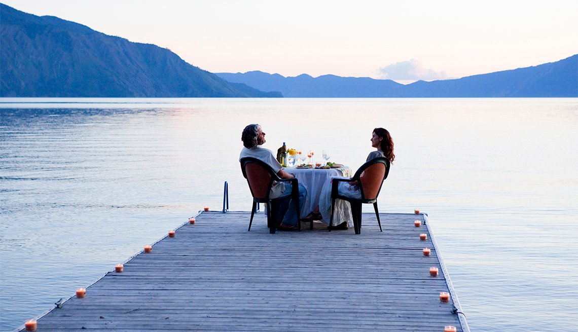 couple eating dinner on a pier