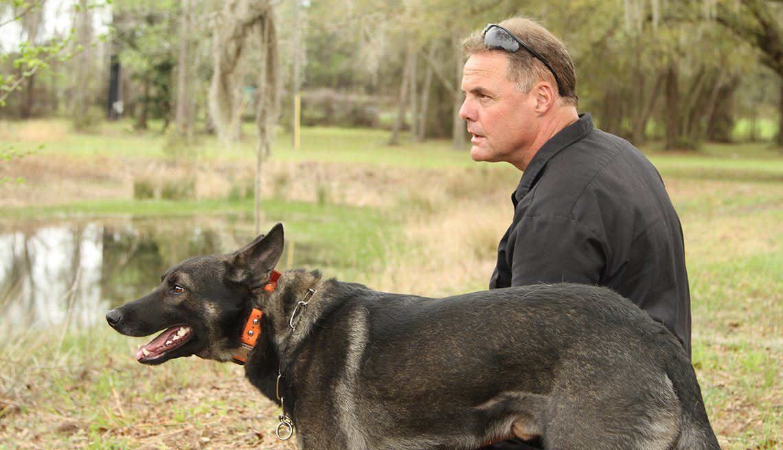 Trainer Jeff Minder helps teach dogs to recognize the scent of COVID-19.
