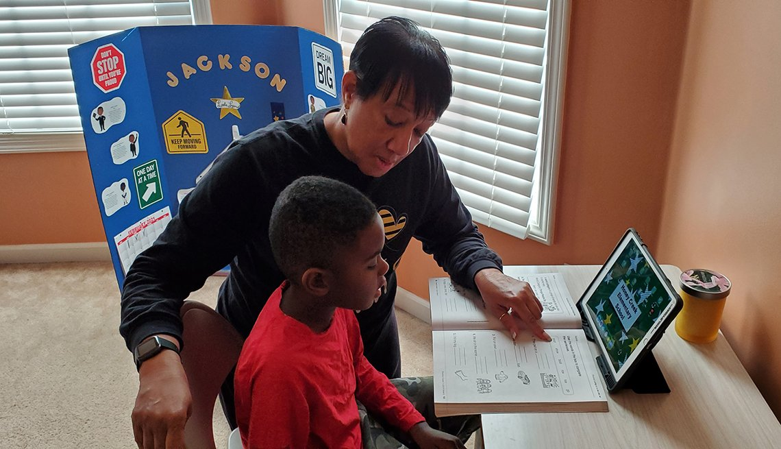 Grandmother helps with teaching during virtual schooling