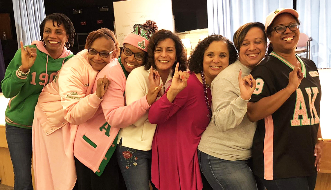 Members of the AKA sorority, smiling for a photo