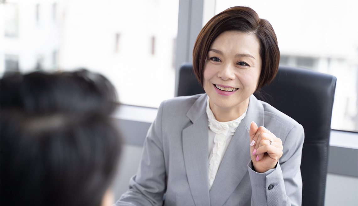 Chinese businesswoman consulting to her partner at a meeting