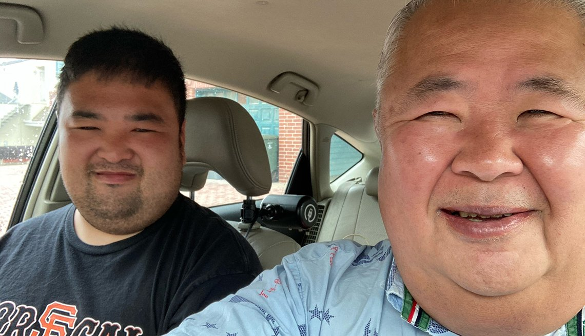 jon yoshimine in the car with his son