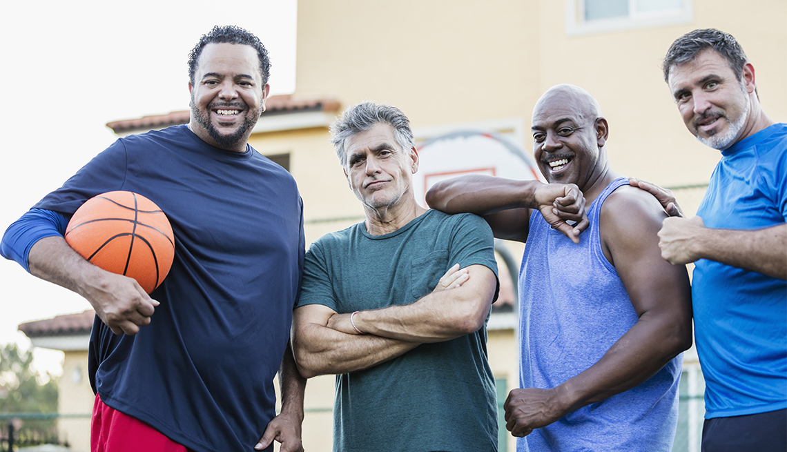 A multi-ethnic group of men on an outdoor basketball court