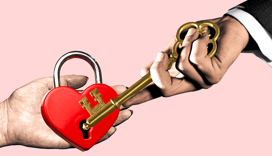 photo illustration of a womans hand holding a heart shaped lock and a mans hand holding a key that is trying to open the lock