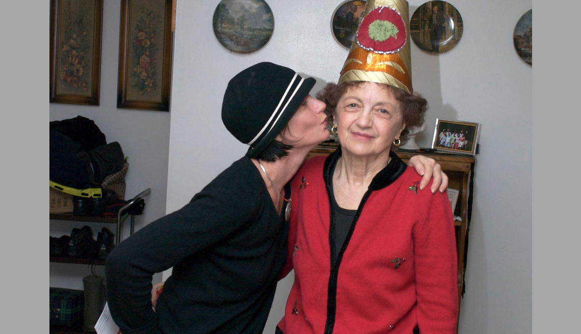 item 1 of Gallery image - Sherry Richert Belul kissing her mother on the cheek