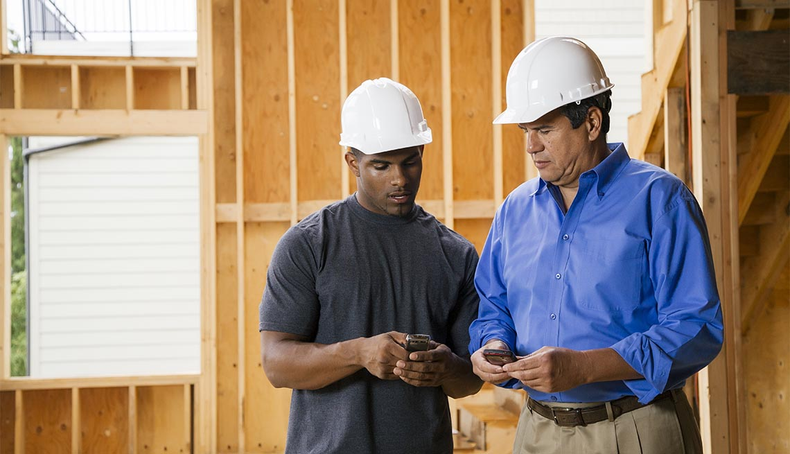 Construction workers texting on cell phones