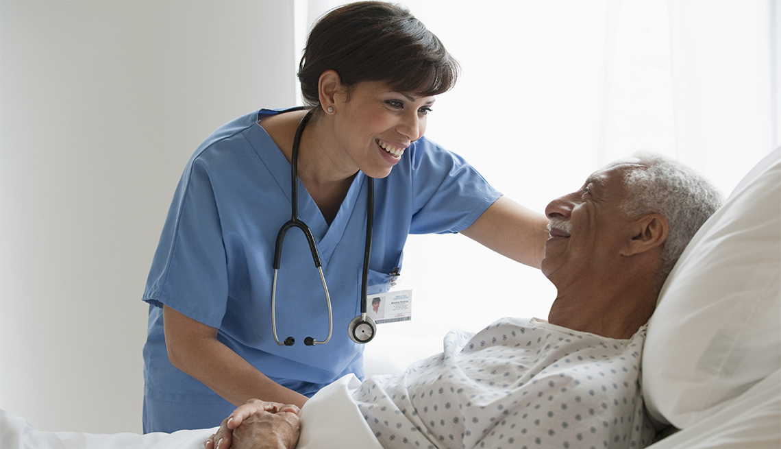 smiling nurse comforts patient in hospital