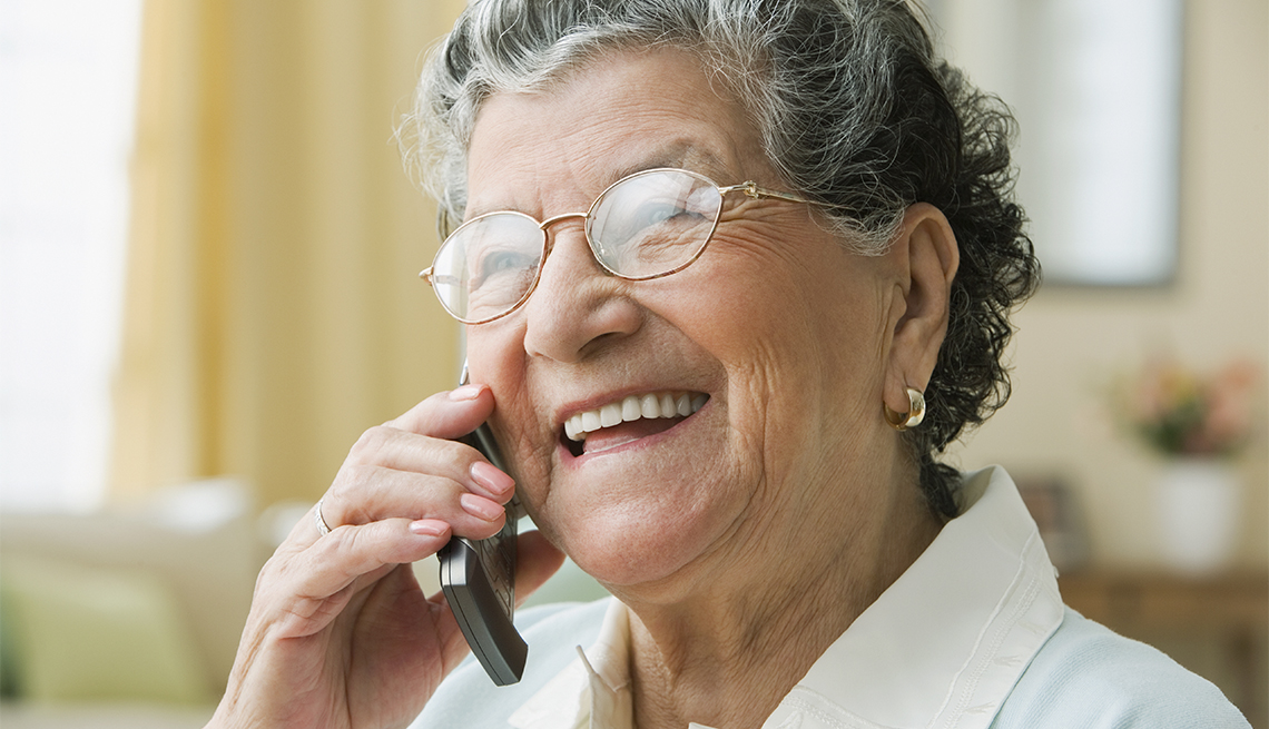 a woman talking on a mobile phone smiling