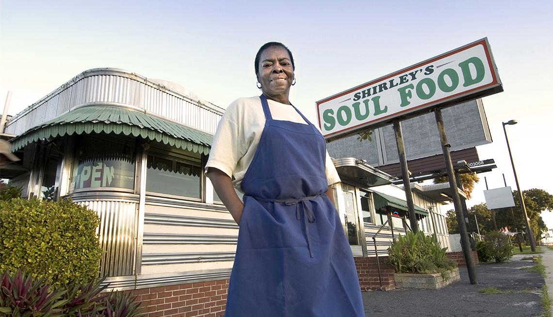 female business owner standing outside her soul food restaurant
