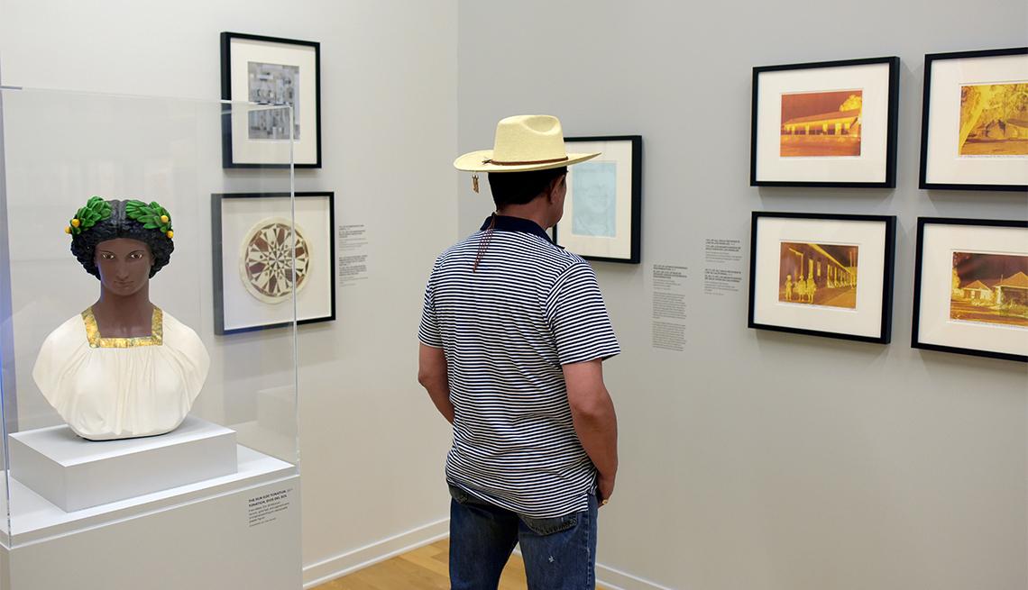 """a man attending the """"Linda Vallejo: Brown Belongings"""" exhibit at La Plaza de Cultura y Artes in Los Angeles."""