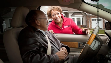 Penny Corum, a a teacher for AARP's Driver Safety Initiative, instructs her father, John Henderson, in driver safety