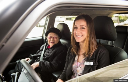 Misty Franklin, a driver with SilverRide picks up one of her clients, Agnes Bunn, at her home in San Francisco, CA.