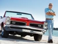 Senior adult on the beach with a restored 1967 convertible GTO. Driving Resource Center (Istockphoto)