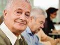 Senior man looking at camera in meeting. Driving resource center (Istockphoto)