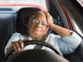 African American woman driving car in traffic. Driving resource center (Blend Images/Getty Images)