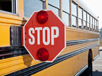 Stop sign on side of yellow school bus, Driving Resource Center