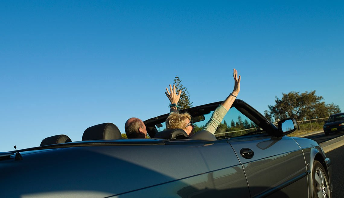 Couple driving in a new car (Photo provided by TrueCar) - AARP Auto Buying Program