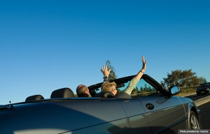 Couple driving in a convertible (Photo provided by TrueCar)