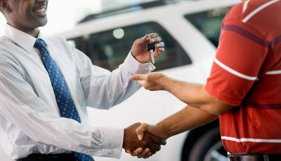 Buying a car - shake hands and keys